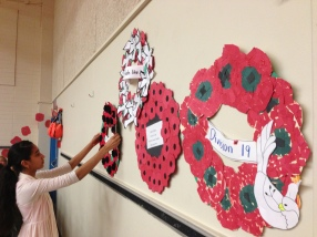 Prabhjot lays a Remembrance Day wreath
