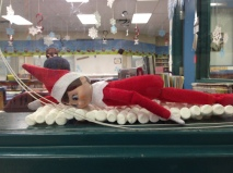 The Vanier Elf takes a nap in the Learning Commons.