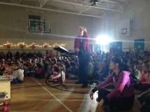 Mrs. Scheller leads students during a Christmas Concert number.
