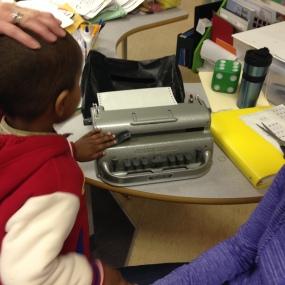 Samatar teaches others how to use the Brailler