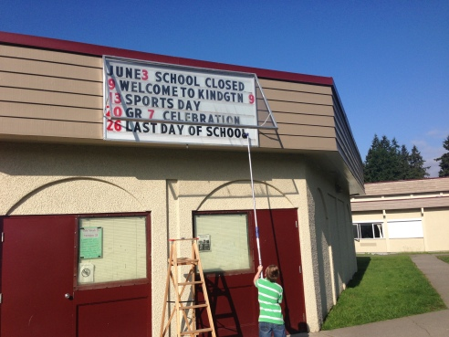 Lukeus helps change our sign and keep the Vanier community informed.